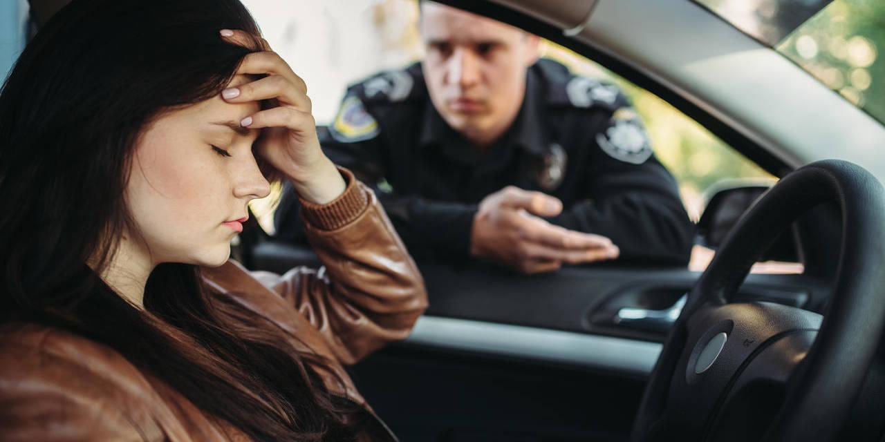 mulher é multa por excesso de passageiro